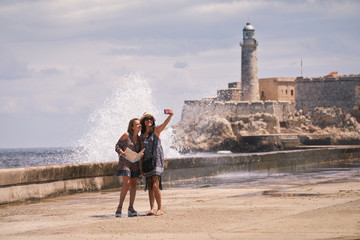 Tourist Girls Taking Selfie With Mobile Phone In Havana Cuba