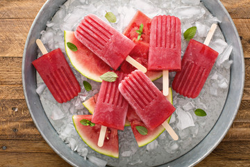 Watermelon and strawberry popsicles