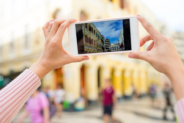 Woman taking photo in Senado Square of Macao