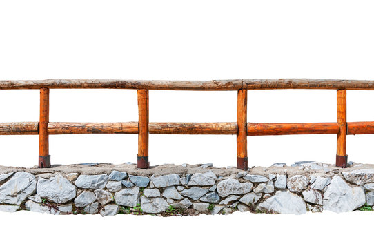 Wooden fence on a stone wall isolated on white background