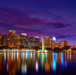 Wall Mural - Orlando skyline sunset at lake Eola Florida US