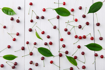 Sweet fresh cherries on white wood background