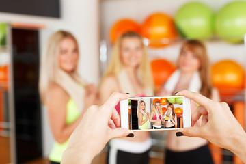 Taking photo of girlfriends. POV image, smartphone screen