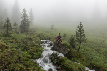 Man in traditional Lederhosen in the Nature of Austria