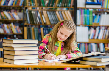 teen girl studying in the library