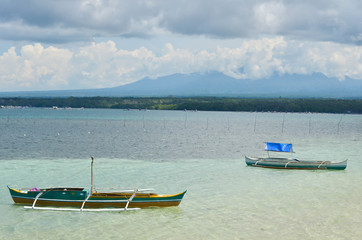 Two fishing boats in the shallow sea in the Philippines photo