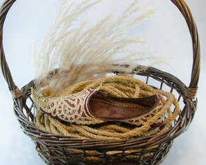 Indian shoe king wicker brown basket isolated on white