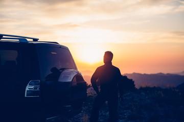 Man watching sunset in mountains