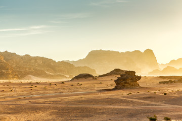 Poster de jardin Desert de sable Desert Landscape of Wadi Rum in Jordan, with a sunset, stones, b