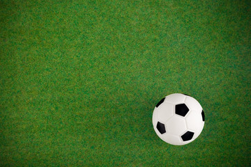 Soccer football field grass ball background. Flat lay. Top view