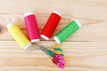 Colored threads on wooden background. Sewing kit. Set for needlework