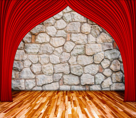 Red curtain in front of rock background with wooden floor