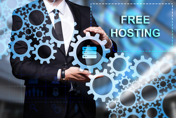 "Glowing gear with icon ""Free Hosting"" in the hands of a businessman. Business concept. Internet concept."