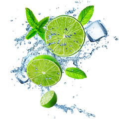 Fresh limes in water splash.