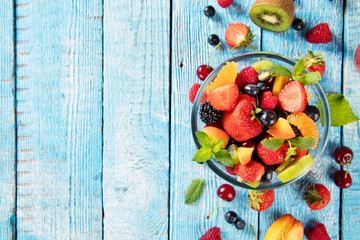 Fresh fruit salad served on wooden table