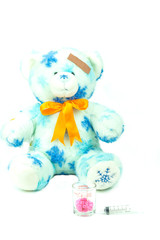 Teddy bear with bandage, drug and hypodermic syringe isolated on