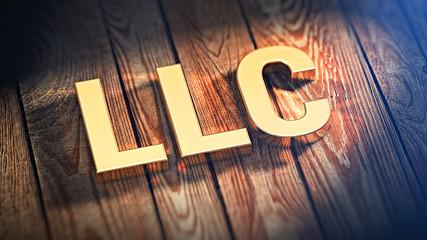 Acronym LLC on wood planks