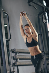 Determined young athlete working out in gym