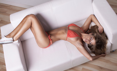 Fashionable photo of young sexy lady wearing red lingerie, amazing body.