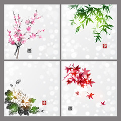 Set of compositions reprezenting four seasons. Sakura branch, bamboo, chrysanthemum and red maple leaves. Traditional Japanese ink painting sumi-e. Contains hieroglyph - happiness.