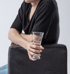 Man holding a glass of clean drinking water.