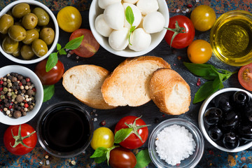 mozzarella, ingredients for the salad and bread, top view