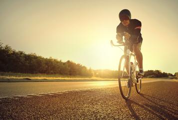Man racing road at sunrise