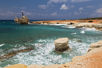 maritime landscape - boat shipwrecked , turquoise sea with waves