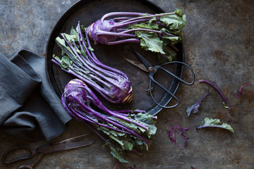 Overhead view of purple kohlrabi being prepared