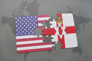puzzle with the national flag of united states of america and northern ireland on a world map background