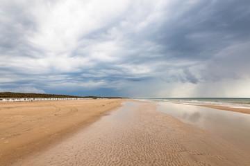 Beach at Lokken in Denmark with dark storm clouds