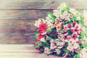 Vintage Alstroemeria Flowers on Wooden Background