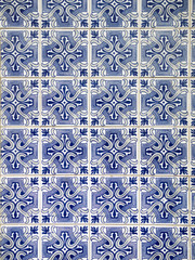 A piece of an old blue ceramic tile in Portugal on the walls of