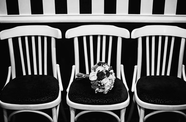 wedding bouquet of red and white flowers on a black and white ba