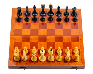 Wooden chessboard with chessmen on white