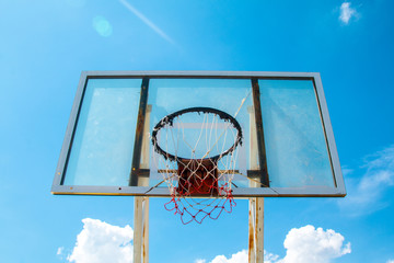 Basketball Outdoor Basketball court net hoop ring board outdoor outside blue sky.