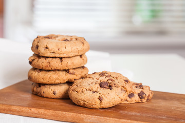 freshly baked chocolate chip cookies on table. Selective focus.