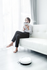 Modern life concept,  woman relaxing with tablet, automatic robo