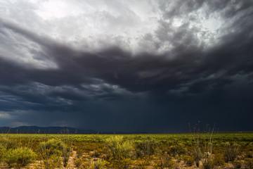 Dark storm clouds over the desert