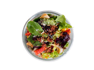 Top view of mixed salad in glass container isolated on white
