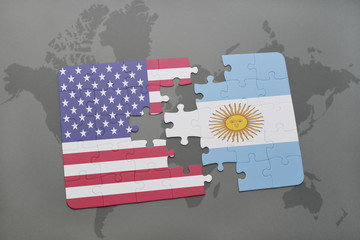 puzzle with the national flag of united states of america and argentina on a world map background