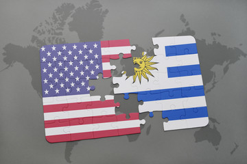 puzzle with the national flag of united states of america and uruguay on a world map background
