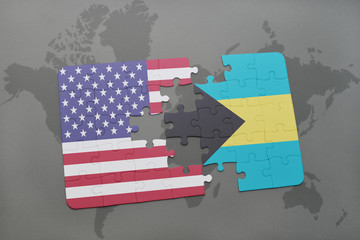 puzzle with the national flag of united states of america and bahamas on a world map background
