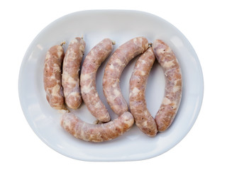 Homemade sausages raw on the plate