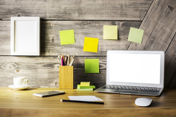 Designer desktop with laptop closeup