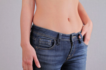 Woman body, belly fat, muffins. Weight loss, dieting concept