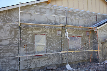 New home construction stucco plaster wall and scaffold system jo