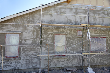 Masonry contractor scaffolding on new home construction job site