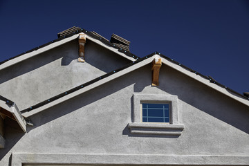New home construction double gable roof and stucco