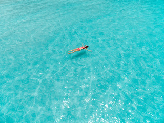 Woman at water surface